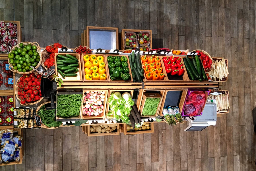 a birds-eye view of a fruit and veg cart, full of crates of fresh foodstuffs