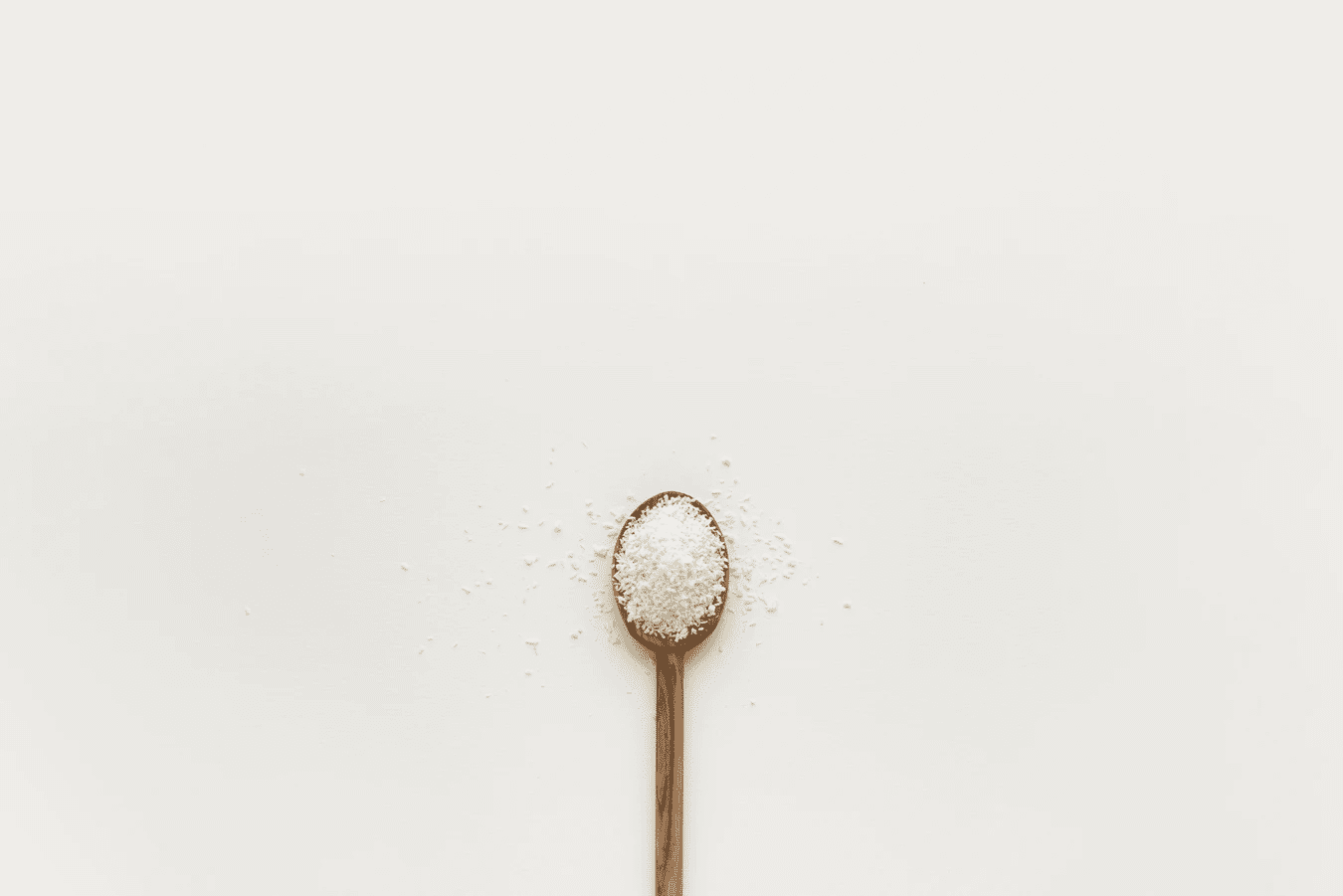 a birds-eye view of a wooden filled with powder on a white background