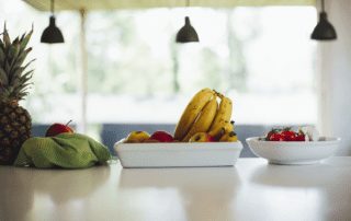 a healthy collection of fruit on a kitchen counter